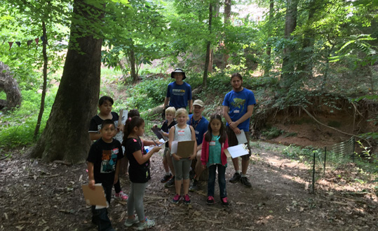 Campers walking in the forest