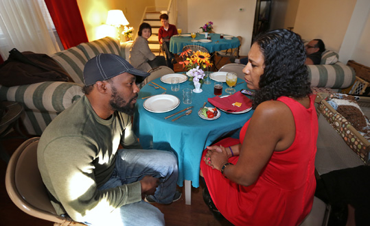 As part of community outreach, members of Broadway United Methodist Church and the community meet for a meal and conversation at Sarah Killingsworth's home, Saturday, March 14, 2015.  This night's topic was entrepreneurship.  In this photo, De'Amon Harges
