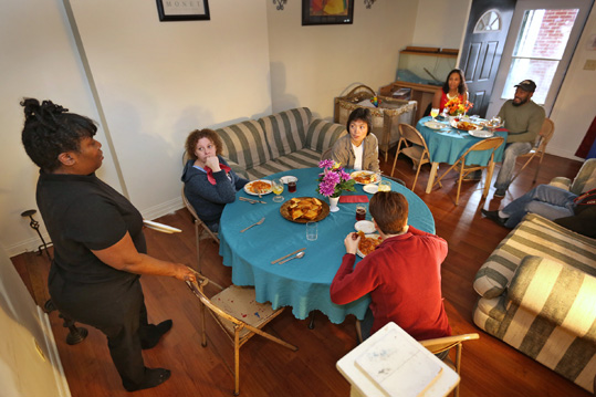As part of community outreach, members of Broadway United Methodist Church and the community meet for a meal and conversation at Sarah Killingsworth's, left, home, Saturday, March 14, 2015.  This night's topic was entrepreneurship.