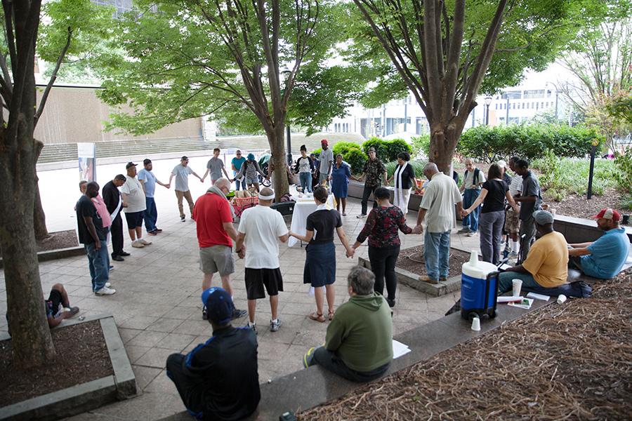 Group prayer outdoors