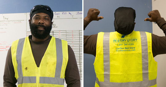 Man wearing an IN EVERY STORY safety vest