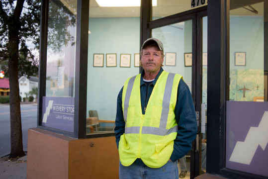 Man in safety vest outside In Every Story office