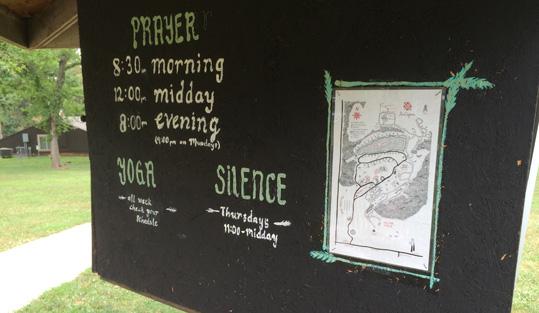 Sign showing prayer schedule
