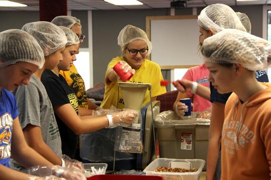 Teens preparing food