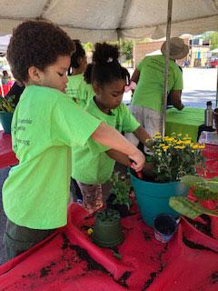 Kids potting plants
