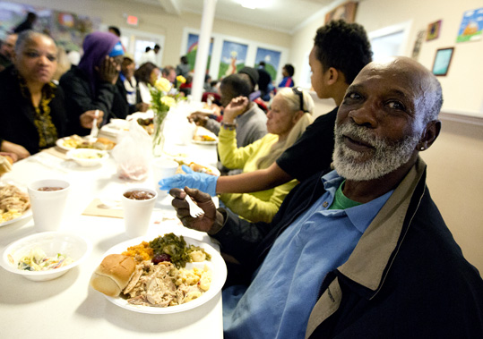 Man enjoys lunch at the Triune Mercy Center