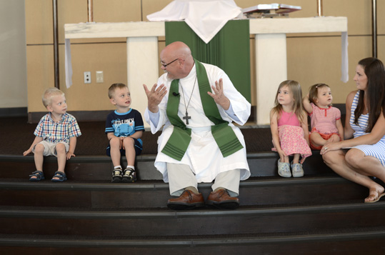 Rev. Jay Schrimpf with children at Bethlehem Church