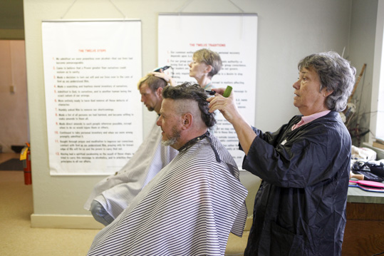 "Free haircuts are offered every Wednesday. Warren ""Cherokee"" Formann gets a haircut from volunteer Sharon LeDuc."