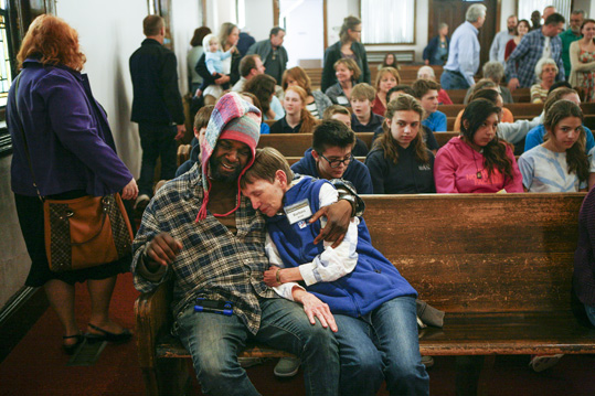 Haywood Street Congregation members participate in a worship service.