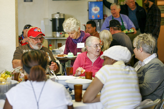 Haywood Street Congregation members are served lunch.