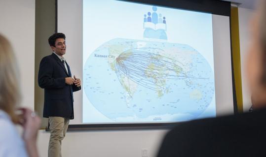 Voleti giving presentation