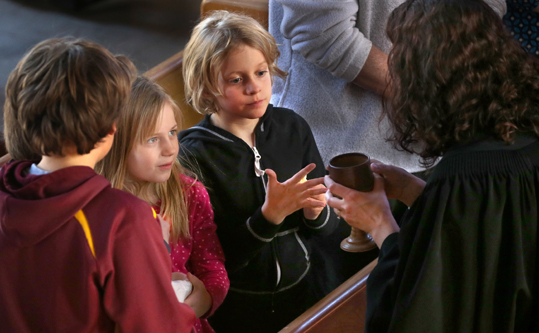 Kids receiving communion