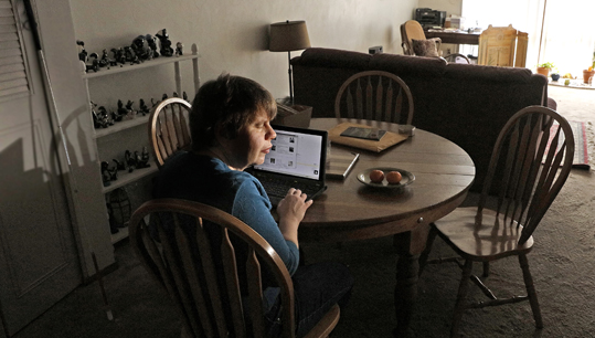 Blind woman listens to the NY Times on her laptop computer