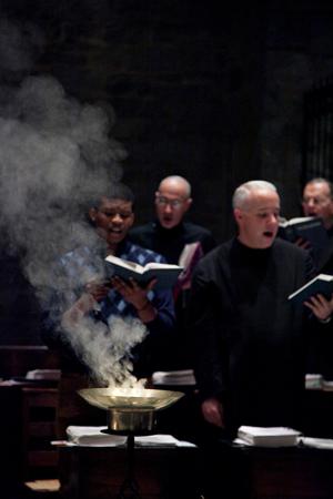 Monks singing, incense burning